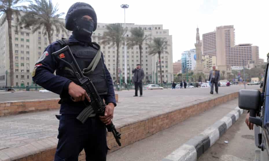 A member of the Egyptian security forces stands guard in Tahrir Square, Cairo.
