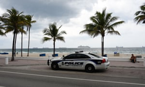 A Fort Lauderdale police car patrols Fort Lauderdale beach on Friday. The beaches in Broward County are closed due to the Covid-19 pandemic but Governor Ron DeSantis is easing some restrictions.