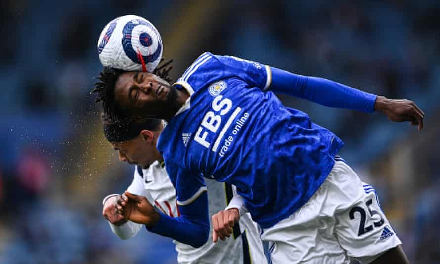 Leicester's Wilfred Ndidi and Dele Alli of Tottenham battle for a header in the Premier League in May