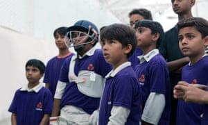 boys in cricket kit