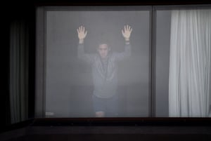 A tennis player waits in his hotel for a training session in Melbourne as players remain in quarantine for two weeks ahead of the Australian Open tennis tournament.