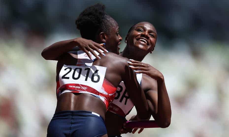Daryll Neita and Dina Asher-Smith of Team GB hug after coming first in round one of the women's 4x100m heats at Tokyo's Olympic Stadium.
