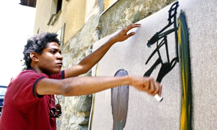 Off the wall: Jean-Michel Basquiat at work.