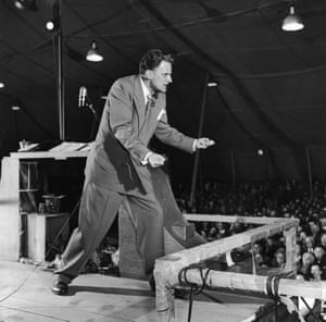Graham preaching in a tent in 1955