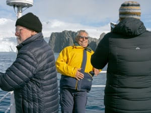 Passengers on board the Ocean Atlantic pose for photographs as the ship positions neat Point Wild, Elephant Island.