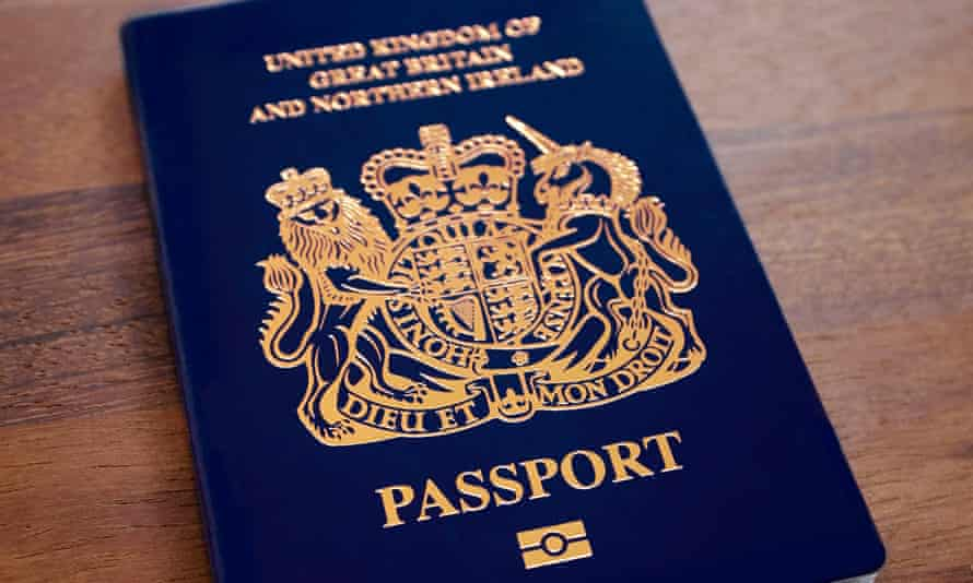 A blue post-Brexit United Kingdom passport on a table top