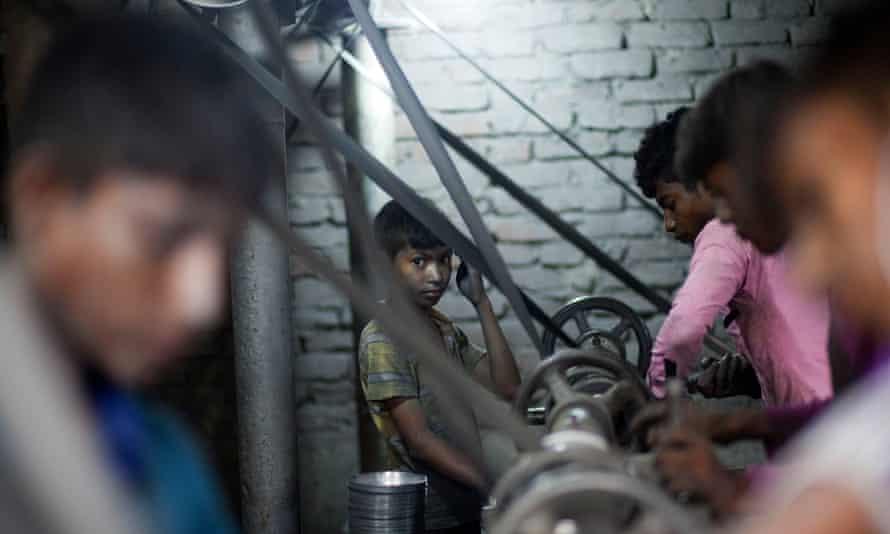 Boys at lathes turning aluminium pots