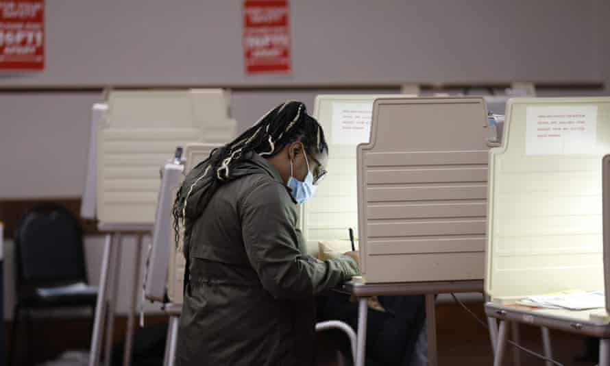 A woman in Detroit votes in the 2020 presidential election.