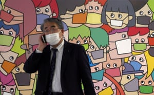 A passerby wearing a protective face mask walks on a street in Tokyo, Japan on 16 April, 2021.