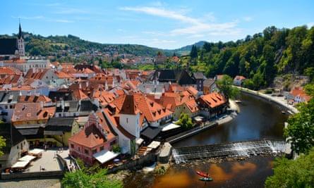 Cesky Krumlov and the Vltava river and canoes, Czech Republic, Europe