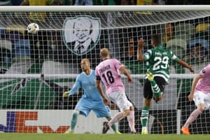 Sporting's Luiz Phellype, right, scores his side's first goal.