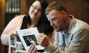 Lilly Ross shows her family photos to Andy Sandness during their meeting at the Mayo Clinic