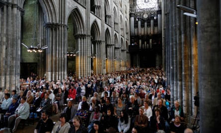 People attend a mass in tribute to Jacques Hamel in Rouen Cathedral
