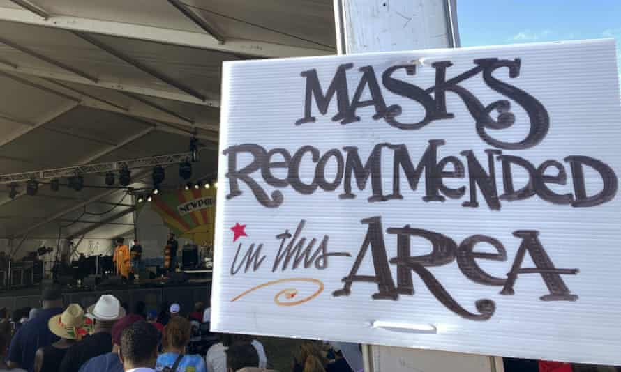 A sign recommends attendees of the Newport Jazz Festival wear masks in a tented area where singer Ledisi performs