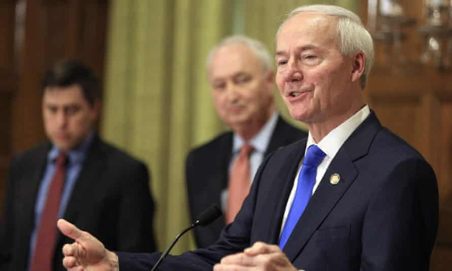 Asa Hutchinson, right, in March 2020. Hutchinson, who signed the bill into law in March, said: 'I signed it because it is a direct challenge to Roe v Wade.'