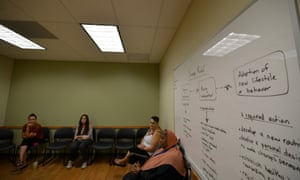 Women participate in a group session at John Brooks.