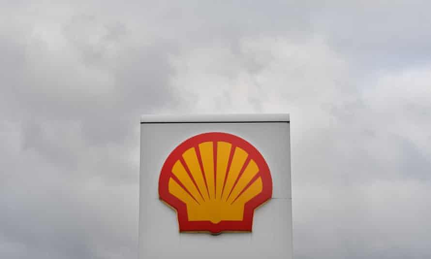 Shell logo against grey sky