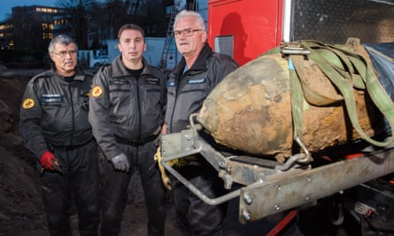 Ordnance survey … Peter Bodes, Joern Kalies and Wilfried Krenz of Hamburg's bomb disposal unit with a defused second world war explosive.