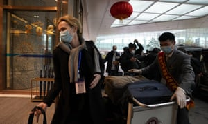 Thea Koelsen Fischer of the World Health Organization team arrive at the airport to leave at the end of the WHO mission in Wuhan, China