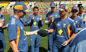 Australian spinner Xavier Doherty is presented with his baggy green cap by Ricky Ponting before making his Australian Test debut in 2010.