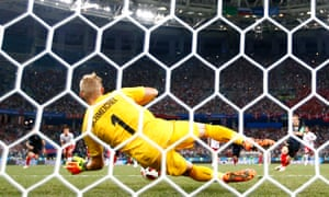 Schmeichel saves a penalty from Luka Modric in the 2018 World Cup shootout against Croatia.