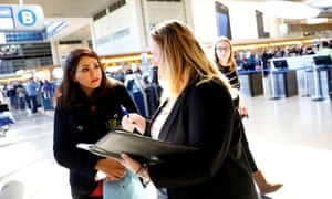 Sarah Saedian speaks with an attorney about her Iranian relatives as lawyers work to help family members of passengers affected by the travel ban at LAX.