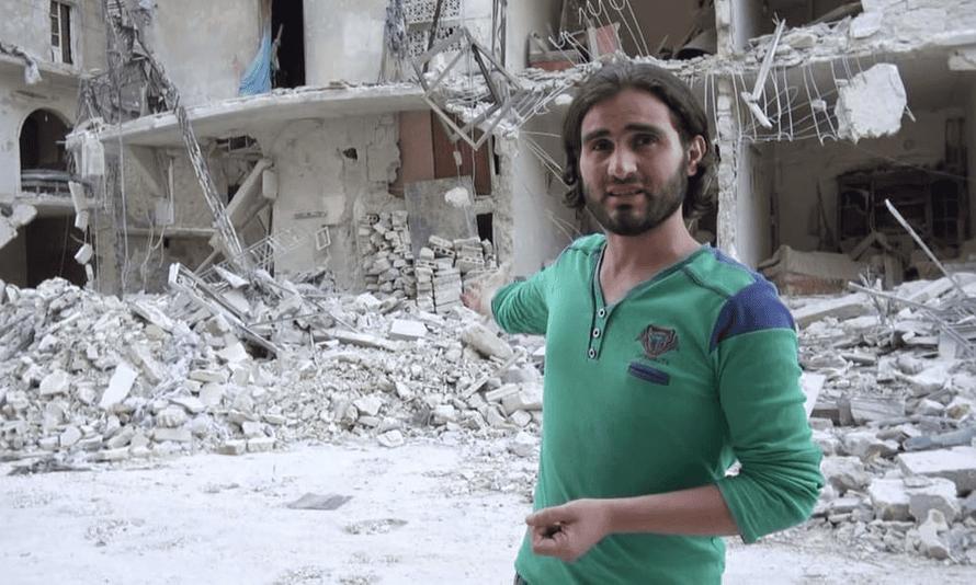 Teacher Abdulkafi Alhamdo, in front of a bombed-out school in Aleppo