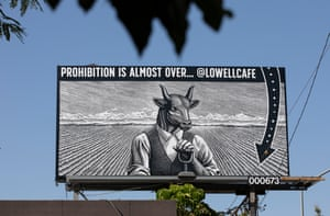 A billboard announces the opening of Lowell Cafe in West Hollywood.