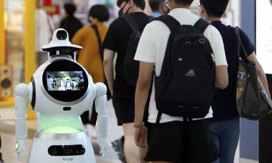 A robot checks the temperatures of passengers at a bus terminal in Gwangju, South Korea