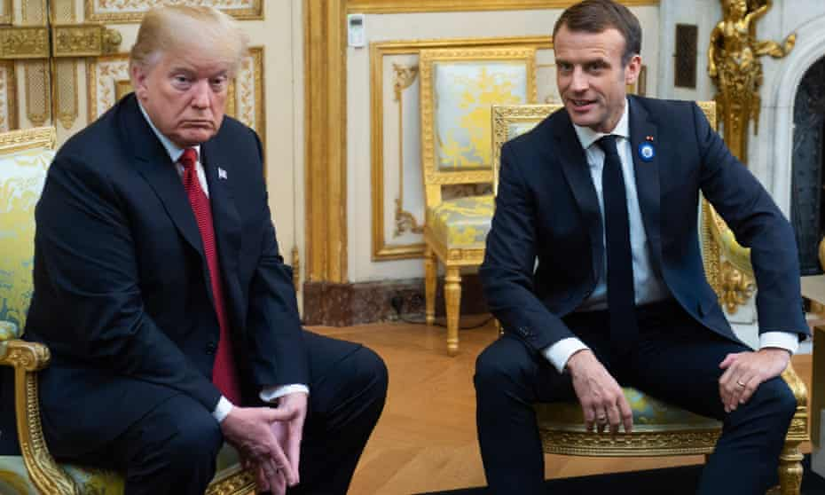 Donald Trump speaks with French president Emmanuel Macron prior to their meeting at the Elysee Palace in Paris on 10 November.