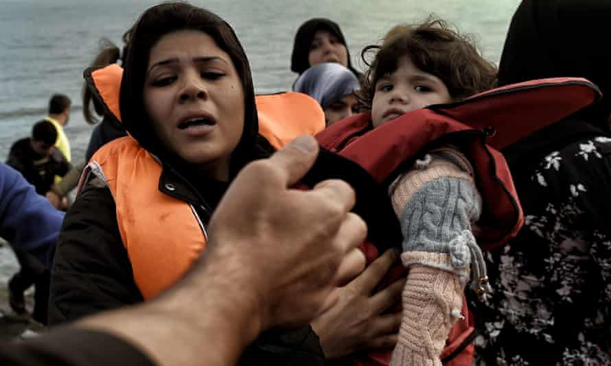 Refugees arrive on Greek island Lesbos from Turkey