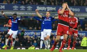 Everton players celebrate after Tom Cleverley's last-gasp missed penalty for Watford.