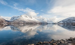 Mirror image … Lyngen Alps reflected in a fjord, Norway.