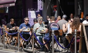 People having lunch at tables outside a restaurant in central London this month.
