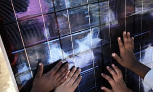 Children touch a solar panel