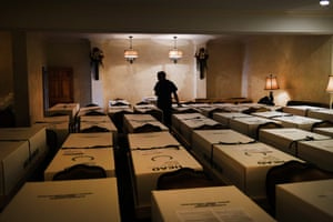 Omar Rodriguez organizes bodies in the Gerard Neufeld funeral home in the Elmhurst neighborhood of Quueens, New York, on 22 April