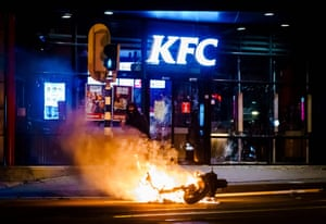 A motorcycle burns during the disturbances in Rotterdam on Monday night.