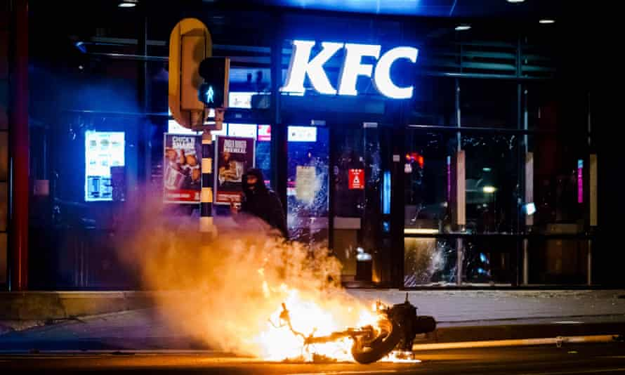 A vehicle burns after being torched by protesters in Beijerlandselaan in Rotterdam.
