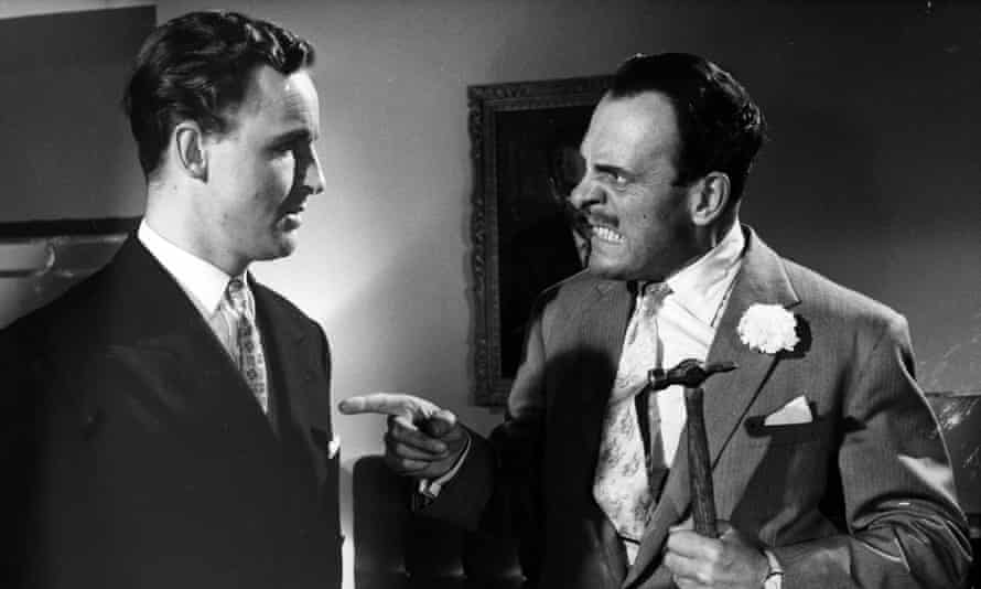 Nicholas Parsons, left, with Terry-Thomas in the 1959 film Too Many Crooks.