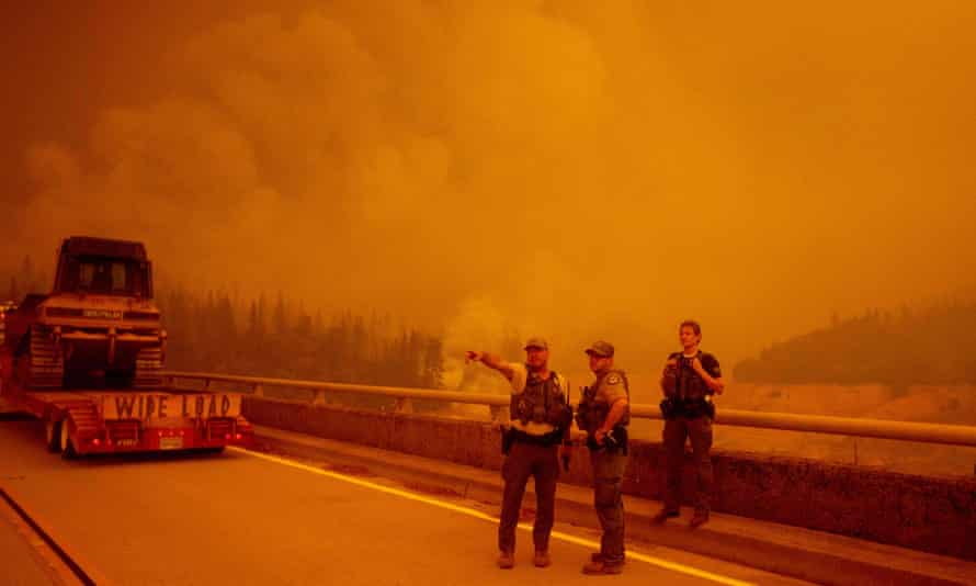 Law enforcement and fire personnel wait on the Enterprise Bridge during the Bear fire in Oroville, California, on 9 September.