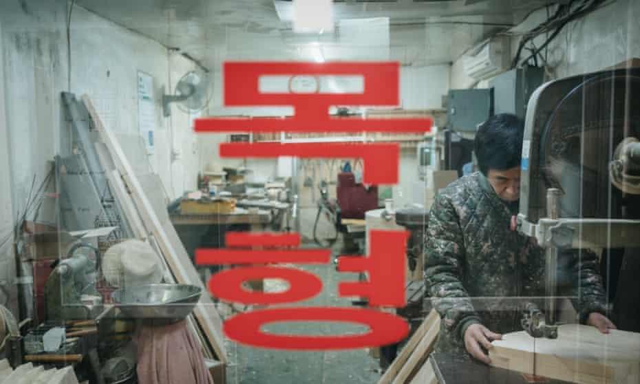 Jang Jong-il, 60, in his wooden model workshop in Euljiro, Seoul.