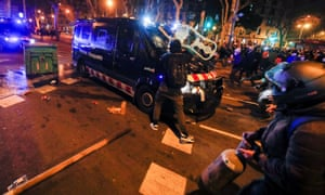 Demonstrators clash with police during a protest against the arrest of Catalan rapper Pablo Hasel in Barcelona, Spain, on Thursday.