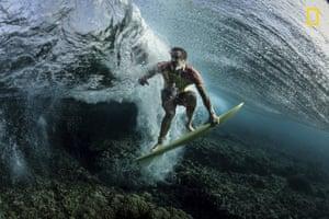 A surfer in Tavarua, Fiji