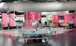 A technician prepares beds in the underground car park of Rambam Health Care Campus which was transformed into an intensive care facility for coronavirus patients.