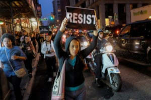 People take part in a protest in New York