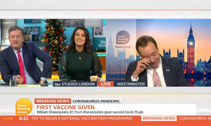 Screenshot from Good Morning Britain of Piers Morgan and Susanna Reid on the left hand side of a split screen, with Matt Hancock on the right hand side wiping away a tear