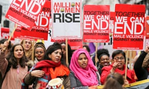 Thousands of people march in London earlier this year to show their opposition to violence against women.