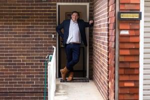 Gus man in doorway wearing ugg boots.