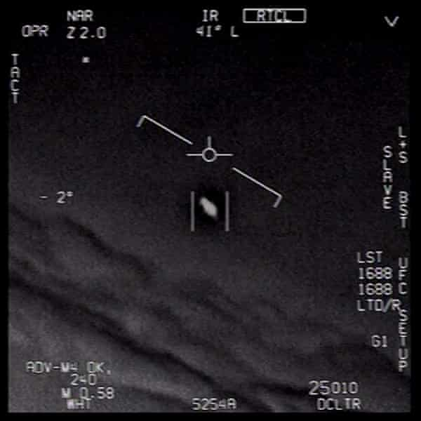 A video grab image taken from an unclassified US navy video authorized for release by the US Department of Defense shows interactions with 'unidentified aerial phenomena'.