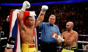 Chris Eubank Jr celebrates winning the fight as Gary O'Sullivan applauds.